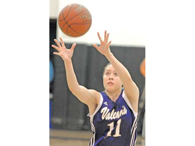 Valencia's Kalia Summerlin shoots a 3-pointer against West Ranch at West Ranch High on Friday. The Vikings' win gave them a co-Foothill League title.