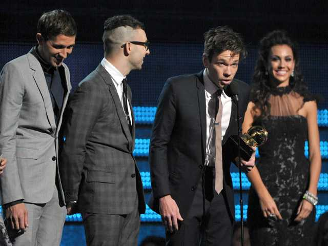 "Members of fun., from left, Nate Ruess, Andrew Dost and Jack Antonoff accept the award for song of the year for ""We Are Young."""