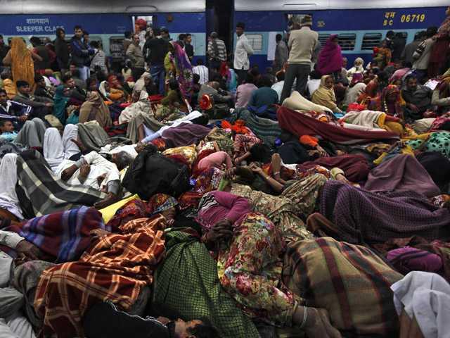 Indian pilgrims sleep on a railway platform in Allahabad, India, Sunday.
