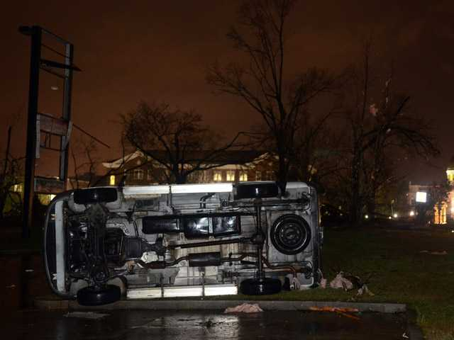 An overturned car lies in front of the University of Southern Mississippi campus in Hattiesburg, Miss.
