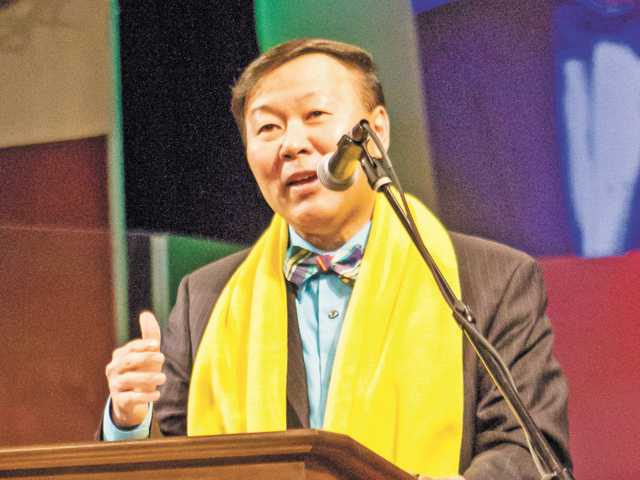Lance Izumi of the Pacific Research Institute, clad in the signature yellow scarf representing School Choice Week, speaks about the growing need for school choice in California. (Courtesy)