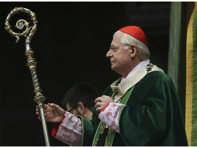 Cardinal Angelo Scola, Archbishop of Milan, celebrates mass.