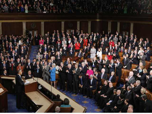 President Barack Obama is applauded as he gives his State of the Union address during a joint session of Congress on Capitol Hill in Washington.