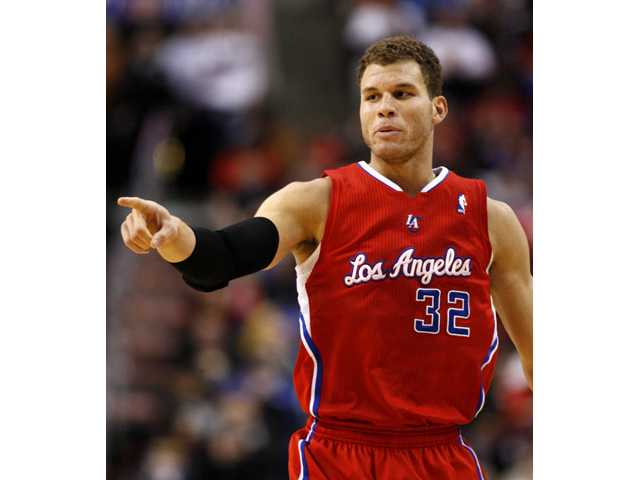 Los Angeles Clippers foward Blake Griffin (32) points after he scores against the Philadelphia 76ers on Monday in Philadelphia.