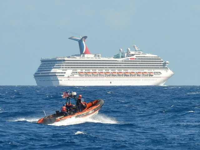 The U.S. Coast Guard patrols near the Carnival Triumph in the Gulf of Mexico on Feb. 11. The cruise ship has been floating aimlessly since a fire erupted Sunday.