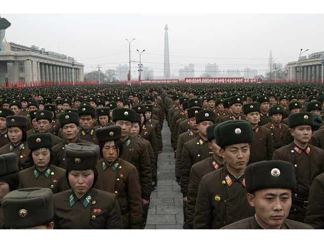 North Korean army officers and soldiers attend a rally at Kim Il Sung Square on Thursday.