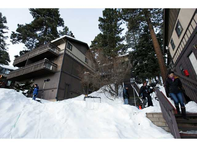 A home, at left, in Big Bear, where the owners of the cabin were taken hostage by fugitive Christopher Dorner.