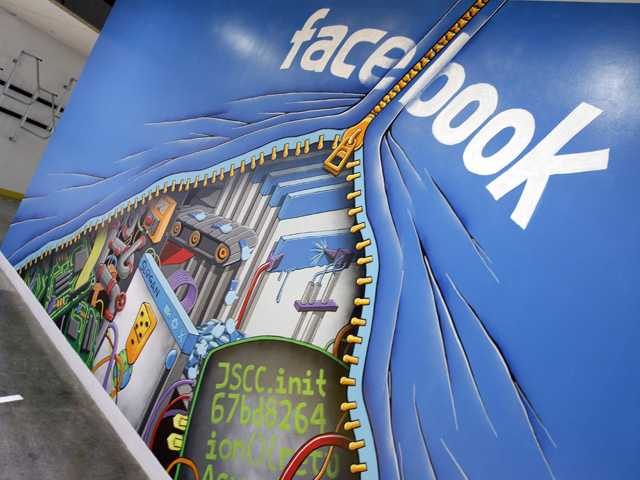 This Feb. 8, 2012 photo shows a mural at Facebook headquarters in Menlo Park, Calif. Intruders recently infiltrated the systems running the world's largest online social network. (AP)