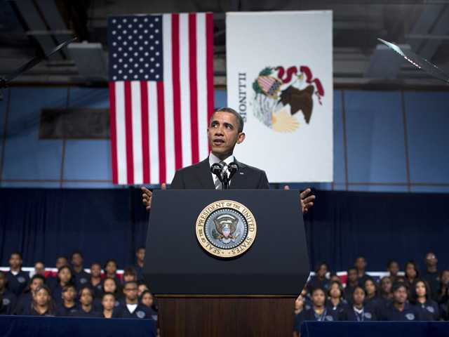 President Barack Obama gestures as he speaks at Hyde Park Academy on Friday in Chicago. (AP)
