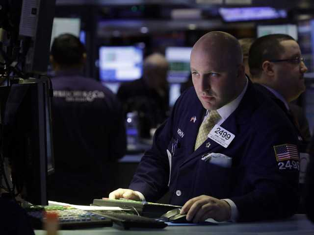 Specialist Joe Parisi works at his post on the floor of the New York Stock Exchange, in New York.