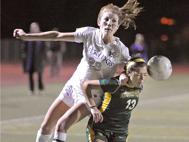 Valencia High's Taylor Venegas (23) heads the ball toward the goal over Moorpark defender Alie Willcox (13) at Valencia High on Thursday.