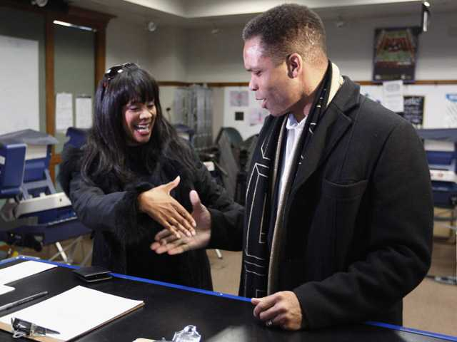 Rep. Jesse Jackson Jr. , D-Ill., and his wife, Chicago Alderman Sandi Jackson arrive at a polling booth in Chicago.