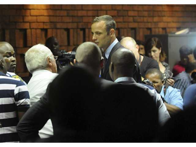 South African athlete Oscar Pistorius at the end of court proceedings, in Pretoria, South Africa.