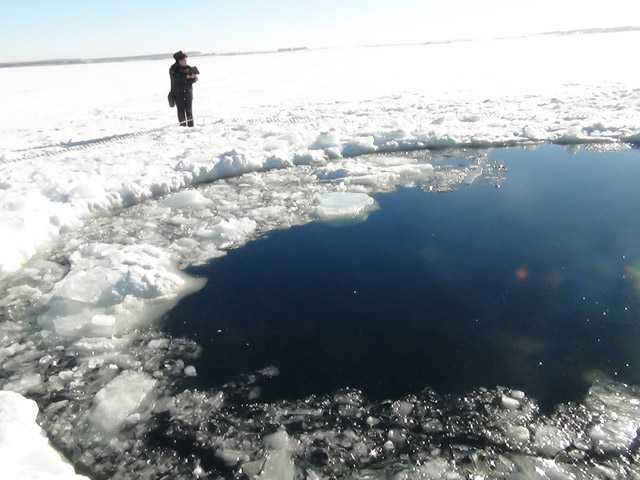 A circular hole in the ice of Chebarkul Lake where a meteor reportedly struck the lake near Chelyabinsk.