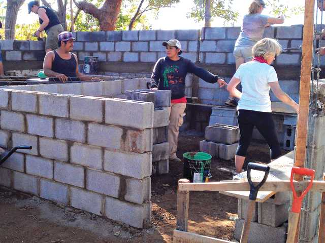 VUMC volunteers work alongside Chacocente residents for the new bathrooms that will replace the elementary school's two outhouses.