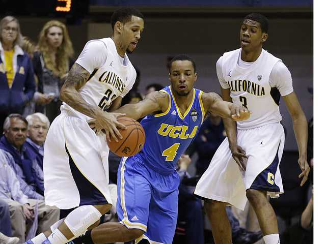 UCLA's Norman Powell (4) defends against California's Allen Crabbe, left, during the first half of an NCAA college basketball game, Thursday, Feb. 14, 2013, in Berkeley, Calif.
