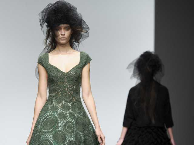 Models wear a design from the John Rocha collection during London Fashion Week. (AP)