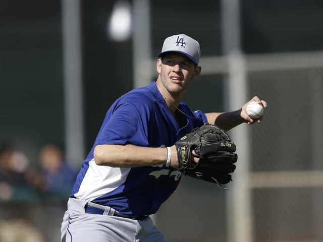 Los Angeles Dodgers starting pitcher Clayton Kershaw (22) throws during spring training baseball at Camelback Ranch in Phoenix, Wednesday. (AP)