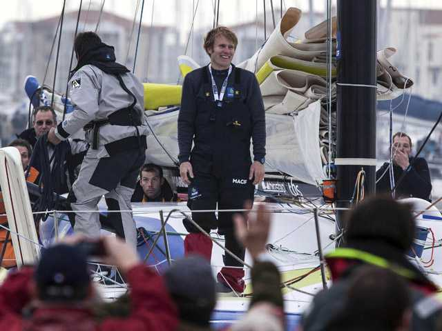 "French skipper Francois Gabart celebrates his victory on his ""MACIF"" yacht after winning the Vendee Globe solo around-the-world sailing race. (AP)"