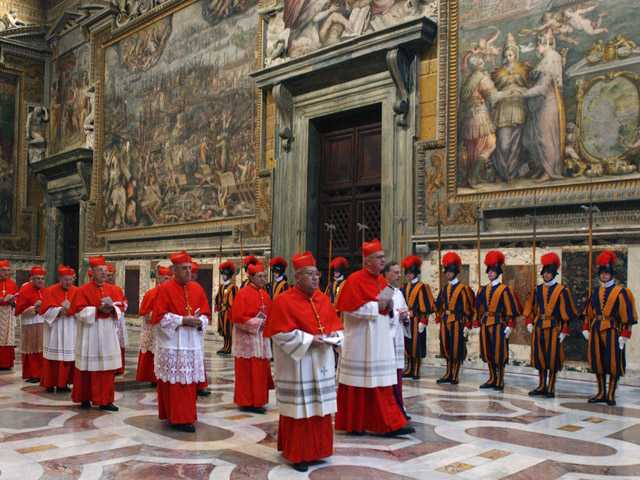 Cardinals walk in procession to the Sistine Chapel at the Vatican, at the beginning of the conclave. (AP)