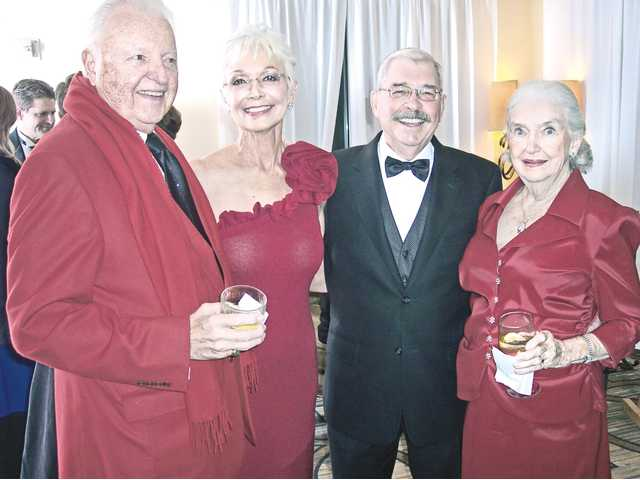 Left to right, Harold Petersen, Dianne and Wayne Crawford and Jacquie Petersen dressed in Valentine's colors for the Sweetheart Gala presented by SCV Women and Men of Honor to benefit cardiac care services in the Santa Clarita Valley.(Michele E. Buttelman/The Signal)