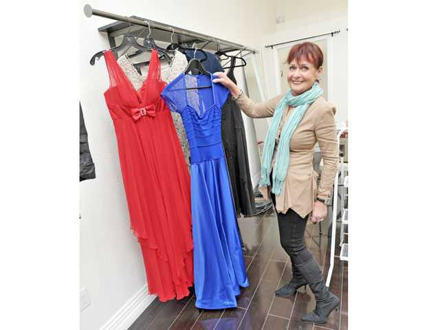 Margo Hudson displays dresses at The Closet on Main in Newhall.