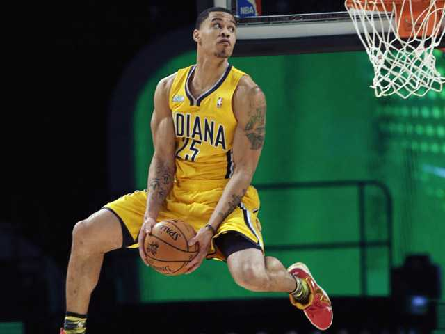 Gerald Green of the Indiana Pacers competes in the dunk contest during NBA basketball All-Star. (AP)