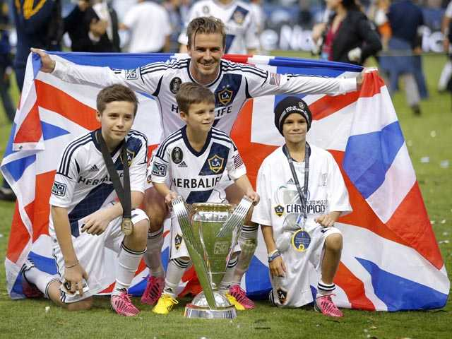 Los Angeles Galaxy's David Beckham, top center, of England, poses with his sons. (AP)