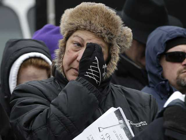 A woman reacts during ceremonies held to unveil plans for a permanent memorial on the site of The Station nightclub fire.