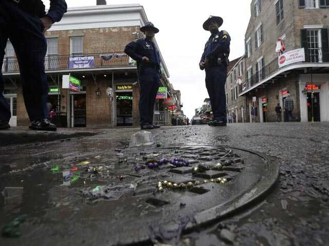 Louisiana State Police stand near the 400 block of Bourbon Street in the French Quarter in New Orleans, Sunday, Feb. 10. (AP)