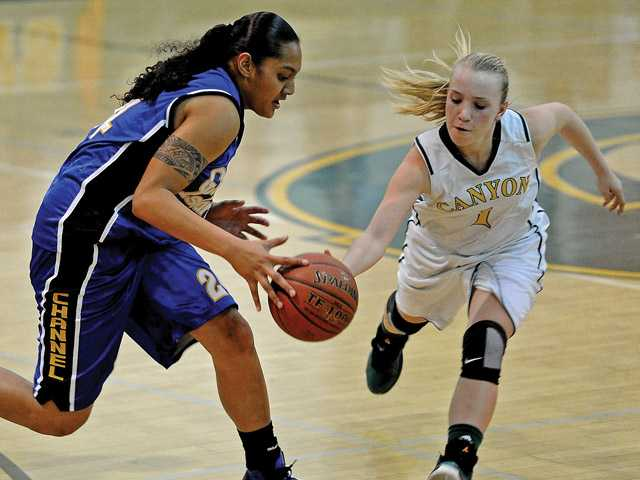 Canyon's Kali Vittallo (1) steals the ball from Channel Islands Tiarah Umu in the second half of the CIF-Southern Section Division IIAA playoffs at Canyon High on Saturday.