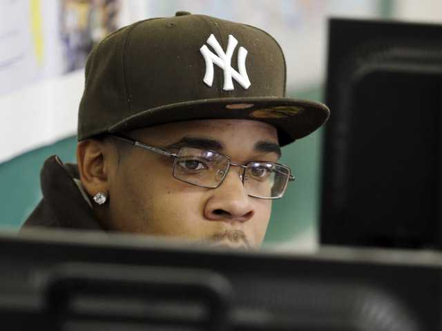 Student Demarcus Miller listens to a teacher from behind a computer terminal in a GED preparation class in Buffalo, N.Y.