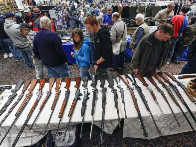 Guns are displayed on a table on display during the annual New York State Arms Collectors Association Albany Gun Show.