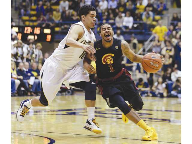 USC's Jio Fontan (1) drives the ball against California's Brandon Smith on Sunday in Berkeley.