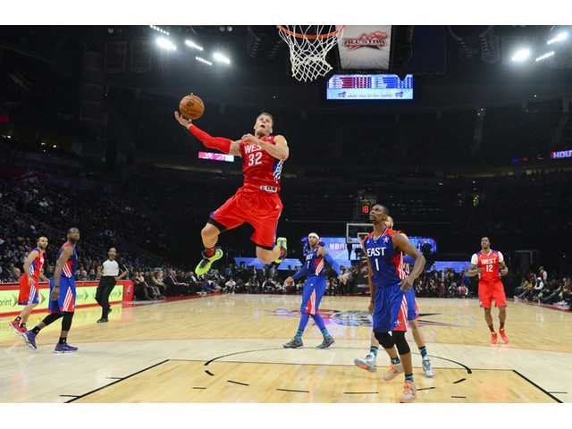 West Team's Blake Griffin of the Los Angeles Clippers goes up for a shot against East Team's Chris Bosh of the Miami Heat on Sunday in Houston.