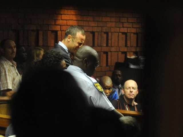 South African athlete Oscar Pistorius reacts, in court in Pretoria, South Africa, Friday, at his bail hearing in the murder case of his girlfriend.