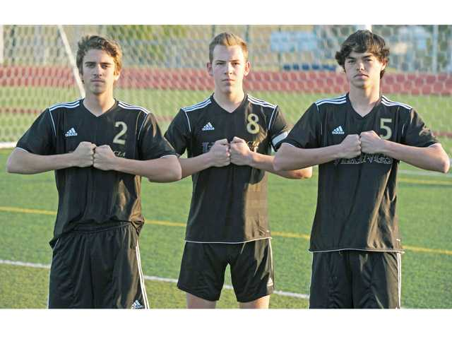 Valencia soccer players, from left, junior Colton Morgan, senior Jake Ferry and junior Lukas Scalercio provide stability for Valencia in the midfield.