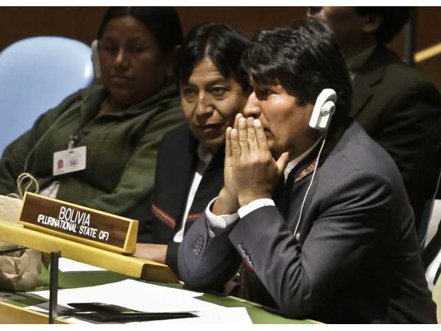 Evo Morales, right, President of Bolivia, listen to speakers at a United Nations General Assembly meeting.