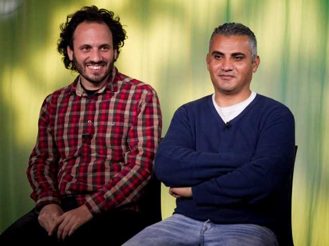 """5 Broken Cameras"" documentary film Co-directors, Israeli, Guy Davidi, left, and Palestinian, Emad Burnat, in an L.A. interview. Burnat was held briefly at LAX."