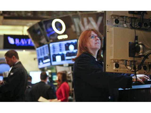 US stocks keep sliding on weak data, Fed qualms