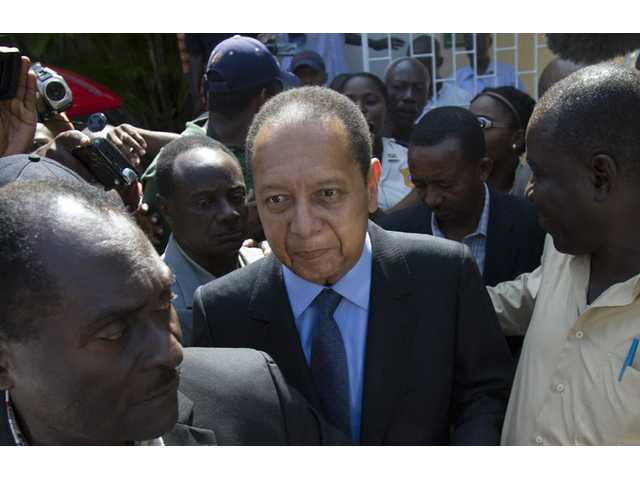 Former Haitian dictator Jean-Claude Duvalier, center, leaves Canape Vert hospital in Port-au-Prince, Haiti.