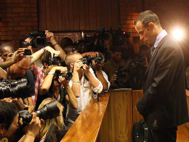Olympic athlete Oscar Pistorius he stands in the dock during his bail hearing at the magistrates court in Pretoria, South Africa, Friday. (AP)