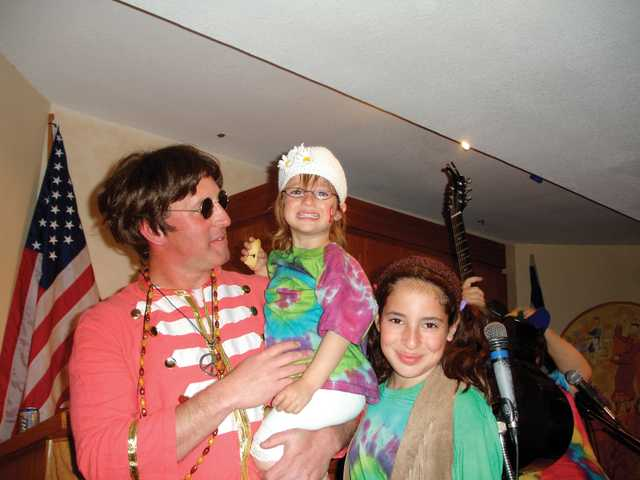 Rabbi Mark Blazer and family celebrating Purim at Temple Beth Ami in 2008 in '60s-themed costumes.
