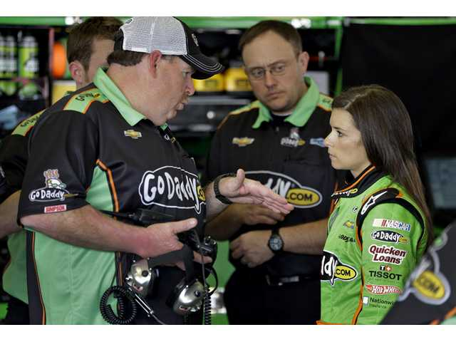 Daytona 500 pole sitter Danica Patrick, right, talks to crew chief Tony Gibson during a practice for the Daytona 500 on Friday in Daytona Beach, Fla.