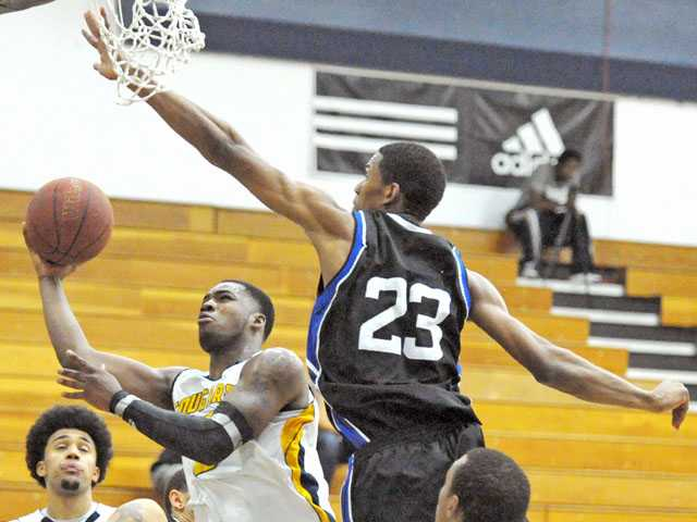 College of the Canyons guard Jaylen Bland shoots over Citrus College defender Jevioin Roland on Friday night at COC.