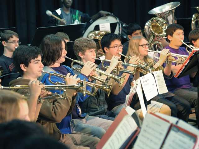 The trumpet section of the William S. Hart Junior High Honor Band 2013 rehearse at La Mesa Junior High School on Wednesday.