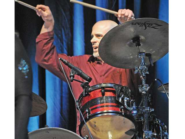"Frankie Martinez plays drums for the ""Funeral of a Friend"" performed at the Songwriter Salute Series featuring the music of Elton John at Hart High School in Newhall on Saturday. Signal photo by Dan Watson"