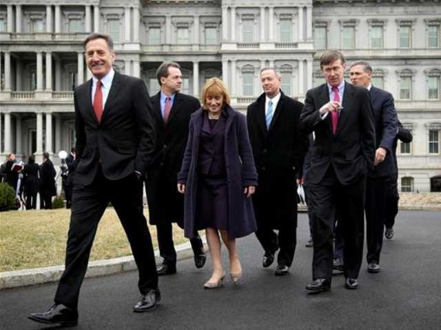 Vermont Gov. Peter Shumlin, left, leads fellow Democratic Governors Associations members along the driveway of the West Wing of the White House in Washington, Friday, Feb. 22, 2013, following their meeting with President Barack Obama and Vice President Joe Biden.