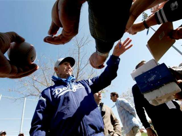Los Angeles Dodgers Hall of Famer Sandy Koufax signs autographs during spring training baseball in Phoenix, Thursday, Feb. 21, 2013.