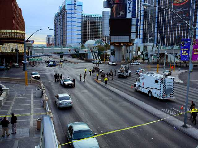 Law enforcement personal investigate the scene of a multi-vehicle accident and shooting in Las Vegas.